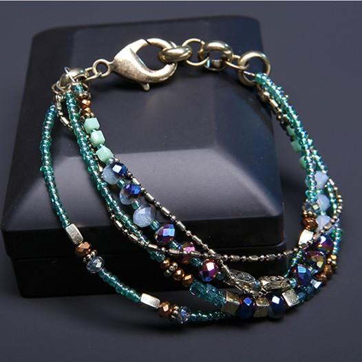 4 reihiges Glasperlenarmband mit stabilem Karabinerverschluß Perlenmix in Grün- und Goldtönen