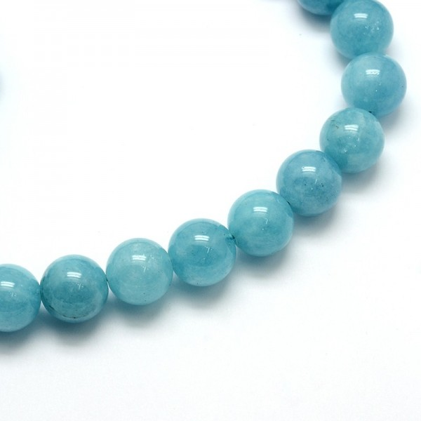 Natürlicher Quarz Perlenstrang türkis glatt glänzend 4 mm (ca. 97 Perlen / ca. 39 cm Länge)