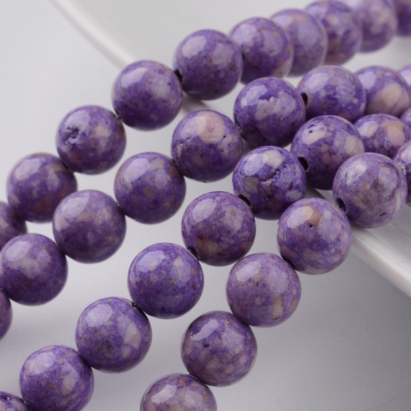 Fossiler Perlenstrang lila gefärbt (ca. 68 Perlen / ca. 39 cm Länge)